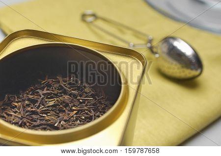 Tea box and strainer