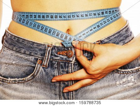 girls stomach measuring with tape twice isolated close up