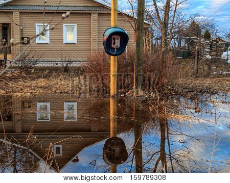 Street in the village, flooding water, spring flooding