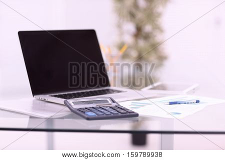 Laptop with blank screen on the table.