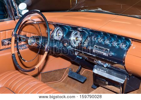 LAS VEGAS NV/USA - NOVEMBER 2 2016: 1955 Chrysler Imperial dashboard with automatic transmission shifter and RCA Victor record player at the Specialty Equipment Market Association (SEMA) 50th Anniversary auto trade show.