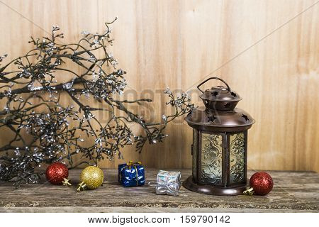 Christmas Decorations On The Wooden Background. Silver Snowflaker, Lantern, Decorative Branches And