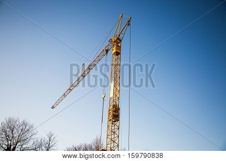 Construction site with crane blue sky, pipework