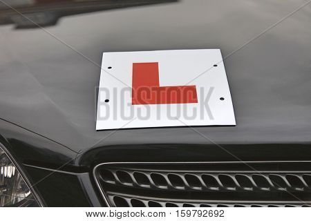 L Plate on hood of car