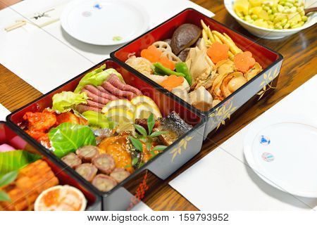 Osechi traditional Japanese New Year food in black lacqueware boxes Tohoku area