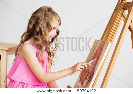 Portrait Of A Lovely Little Girl Painting A Picture In A Studio Or Art School