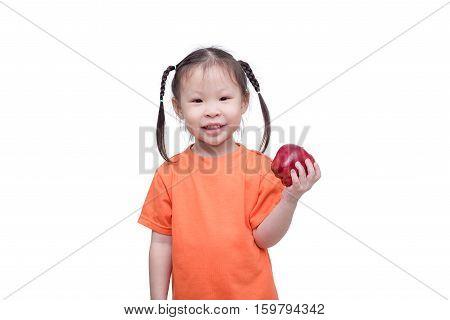 Little asian girl holding an apple over white