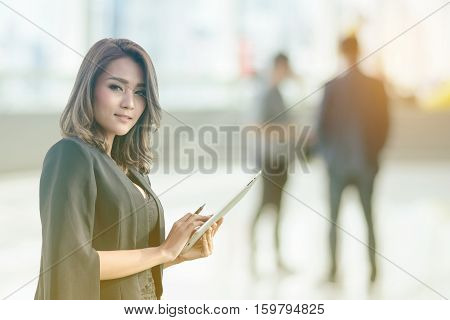 Beautiful asian business woman working at office