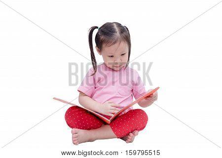 Little asian girl reading book over white background