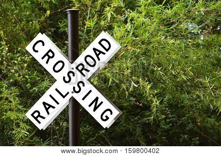 Railroad crossing with barrier or gate ahead