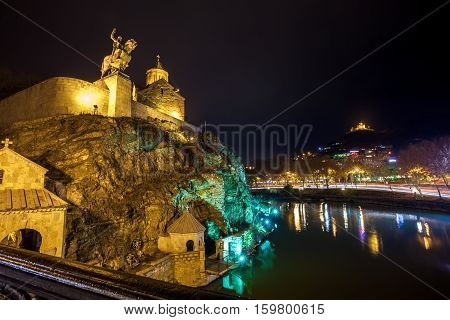 Night Evening Illuminated View Of The Metekhi Church And The Equestrian Statue Of King Vakhtang Gorg