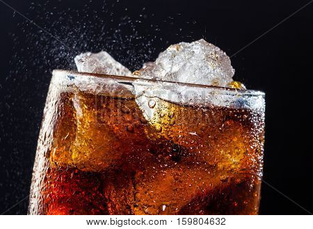 A cool glass of cola drink with ice bubbles and fizz