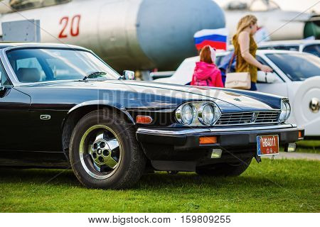 MINSK BELARUS - MAY 07 2016: Close-up photo of black Jaguar XJS 1984 model year. Close-up of old black classic retro car. Selective focus.