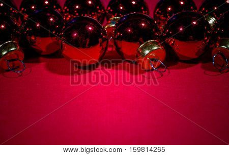 Red Christmas balls on red card background.