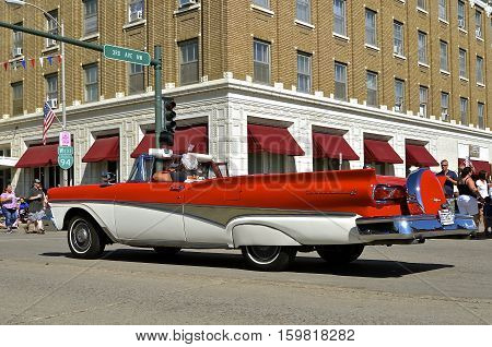 MANDAN, NORTH DAKOTA, July 3, 2016: The 4th of July Rodeo Days  3 day celebration includes the rodeo, Art in the Park, and downtown 4th parade where this 1958 Ford Fairlane retractable convertible is featured.