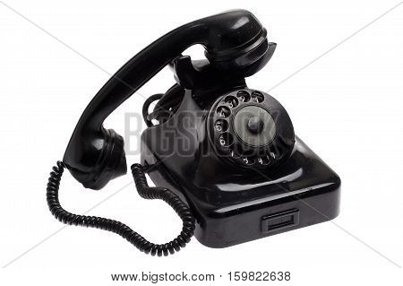 old black vintage style telephone off the hook isolated over a white background