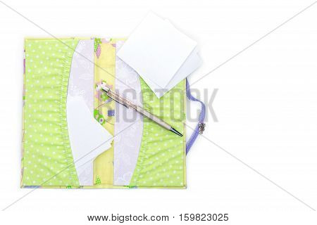 Beautiful handmade scrapbooking holder for travel documents with ribbon closure. isolated on white background. Copy space.