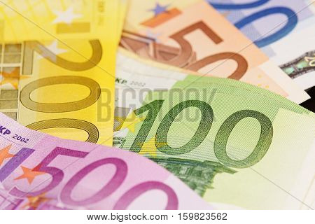Several different euro banknotes on white background