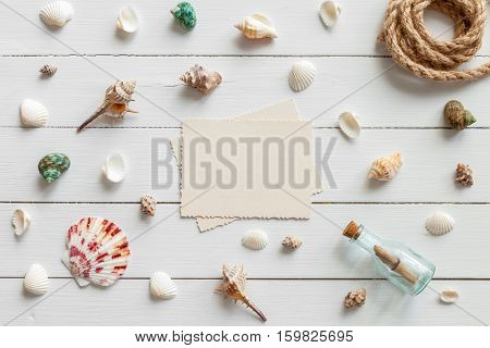 Empty photo for inside and nautical life style items: retro bottle with message sea shells chest rope. Marine concept.