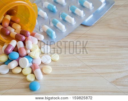 Closeup group of pill and capsule medicine pharmaceutical theme (Selective focus)