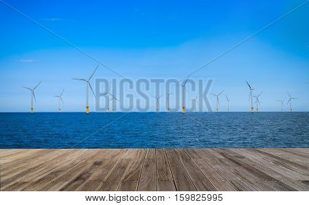 Offshore Wind Turbine in a Windfarm with wooden walkway under construction off the coast of England