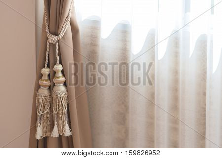 beautiful curtain tie by curtain strap with sunlightselective focus.