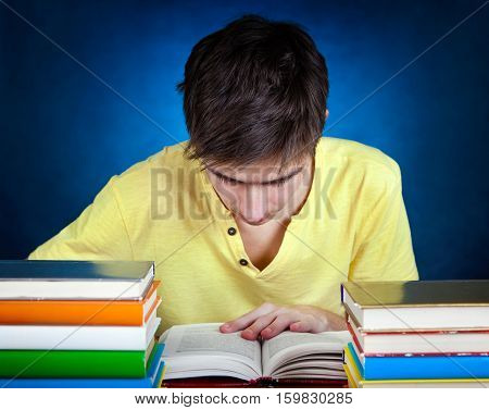 Student with the Books on the School Desk