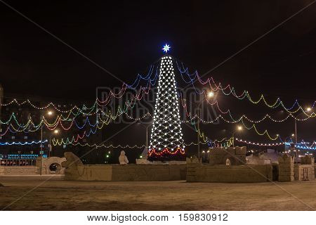 Christmas tree at night on the town square