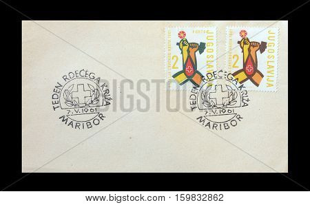 YUGOSLAVIA - CIRCA 1961 : Cancelled First Day Cover Letter printed by Yugoslavia, that shows Helping hands.