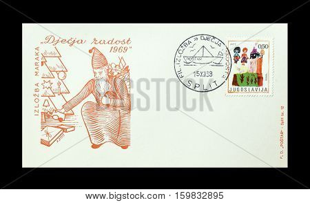 YUGOSLAVIA -CIRCA 1969 : Cancelled First Day Cover Letter printed by Yugoslavia, that shows Santa Claus and children drawing.