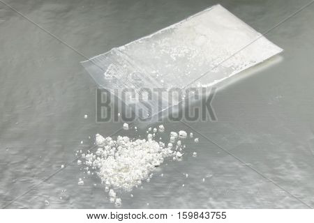 Bag of hard white drug - heroin