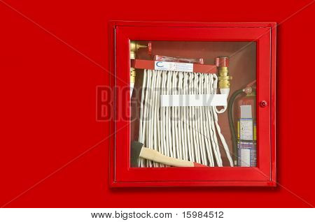 fire extinguisher and hose in the wall