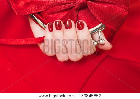 Beautiful Small Red Female Clutch Bag In Hands