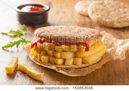 Chip Butty sandwich with potato chips or fries and ketchup