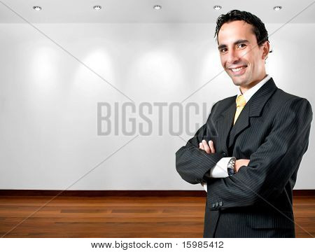 Elegant, young and smiling business man at office