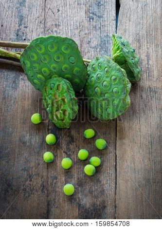 Lotus Seeds And Calyx On Wood Background