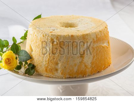 Angel food cake or angel cake is a type of sponge cake made with stiffly beaten egg whites with no addition of butter.
