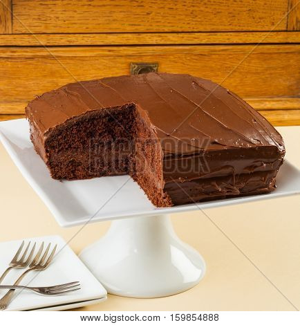 Typical Australian chocolate layer cake on a cake stand.