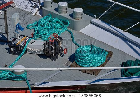 Hank mooring rope and lifting gear anchor on the bow of the ship