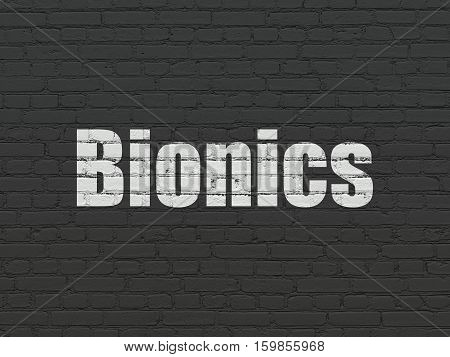 Science concept: Painted white text Bionics on Black Brick wall background