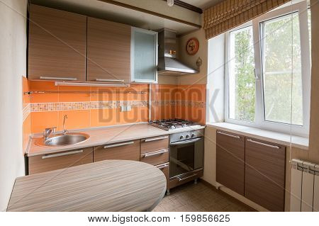 The interior of an empty kitchen equipment for sale