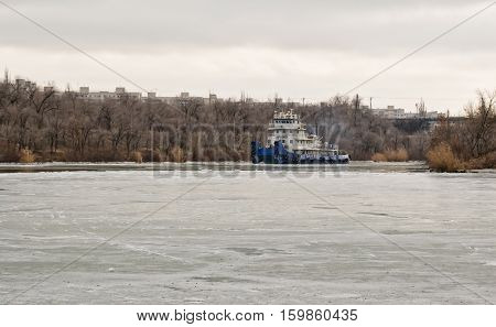 River Tug Floats On The Navigable Channel Is Already Fettered By Ice