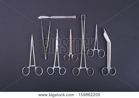 Medical instruments in a steel tray . scalpel