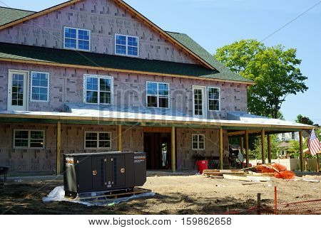 HARBOR SPRINGS, MICHIGAN / UNITED STATES - AUGUST 3, 2016: The Village of Hillside, a senior living community, is under construction on Traverse Street near downtown Harbor Springs.