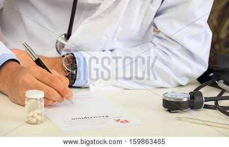 Doctor Writing A Perscription