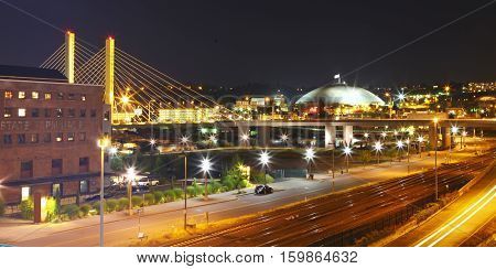 Tacoma Downtown At Night With Dome And Bridge And Highway.