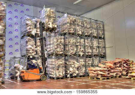 Saint-Petersburg Russia - October 31 2016: Forklift in Freezer cold storage warehouse of meat products.