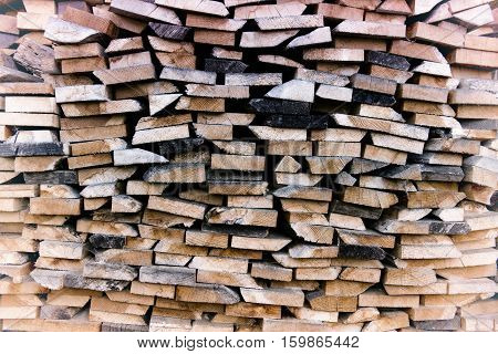 pile of cut wooden planks stacked on top of each other