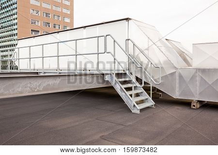 metal staircase with air ducts on the roof