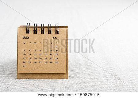 July. Calendar sheet. Two thousand and seventeen year calendar on bright background with copy space on right side.